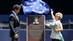 Paul and Nevalee O'Neill unveil Monument Park plaque (USA Today photo)
