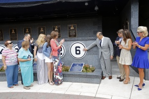 At the latest number retired in Monument Park (left to right) Joe Torre's sisters, Sister Marguerite and Rae; his son, Michael; his daughters Andrea and Lauren; his wife, Ali; Joe; Yankees managing general partner Hal Steinbrenner and his wife, Christina; and Yankees general partner Jennifer Steinbrenner Swindal.