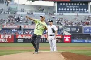 Yankees pitcher Adam Warren watches Richard Albero throw ceremonial first-pitch strike